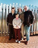 Down´s syndrome. Young woman with Down´s syndrome and her family.
