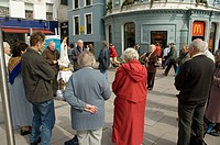 People praying in the street. Cork. Ireland.
