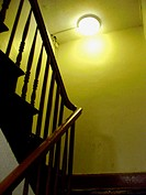 Green staircase in an old New York City apartment building. Hitchcock like feel, spooky and tense. USA