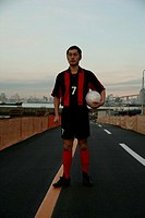 Soccer player on road (thumbnail)