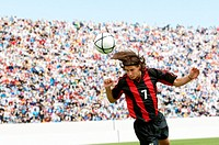 Soccer player heading ball