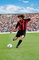 Soccer player striking ball