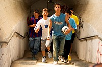 Street soccer team emerging from tunnel