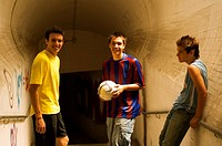 Group of teenage soccer friends in tunnel