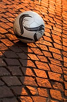 Ball on cobbled stone street