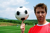 Soccer player spinning ball on finger