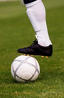 Close-up of foot on soccer ball