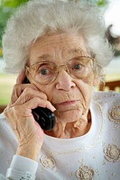 Senior female talks on a cell phone