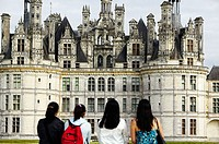 Four women looking at the Chateau of Chambord. Loire Valley. France