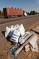 Trash pickup on Interstate highway of litter in Seattle WA by Ecology youth Corps volunteers, in bags for disposal