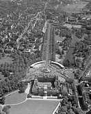 Aerial view looking over Buckingham Palace and down The Mall, showing the grandstands erected for the coronation procession of Queen Elizabeth II.