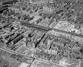 Aerial view of Stepney with St George in the East church and unredeveloped bomb damage.