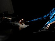Man at his desk in the dark