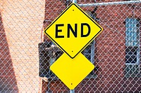 End sign on a fence
