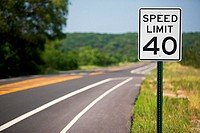 Speed limit sign by the road