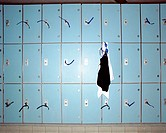 Swimming goggles hanging from locker