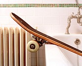 Skateboard in bathroom