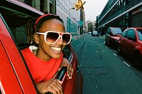 Smiling woman wearing sunglasses