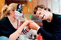Couple wearing face masks in cafe