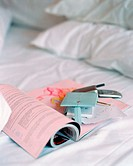Magazine on crumpled bed