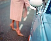 Woman opening automobile door (thumbnail)