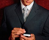 Businessman using handheld computer (thumbnail)