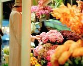 Woman standing near florist