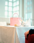 Handbag on restaurant table