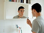 Teenage boy preparing to shave