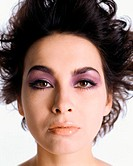 Headshot of woman wearing dramatic makeup