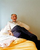 Elderly man on his bed