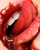 Chocolate sauce spilling out of woman's mouth