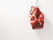 Piece of beef on a hook