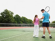 Father and daughter on tennis court
