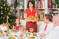 Family at dining table at christmas