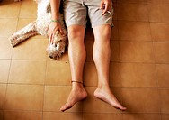 Man and dog on floor