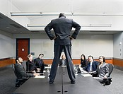 Businessman standing on conference table