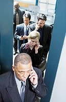 Group of businesspeople using mobile phones