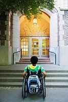 Man in wheelchair looking at steps (thumbnail)