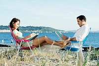 Couple at beach reading together
