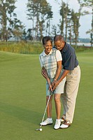 Senior couple playing golf (thumbnail)