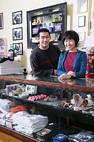 Portrait of couple working in pet shop