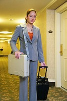 Businesswoman at hotel with luggage