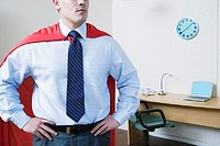 Businessman wearing red cape
