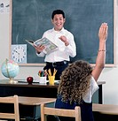 School girl raising her hand in class
