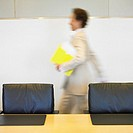 Blurred image of businesswoman walking