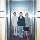 Portrait of three businesswomen in elevator