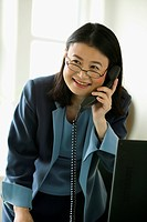 Female businesswoman talking on telephone