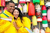 Portrait of couple standing in front of buoys