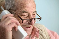Elderly man talking on the phone